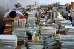 Chinese-student-surrounded-by-book_450